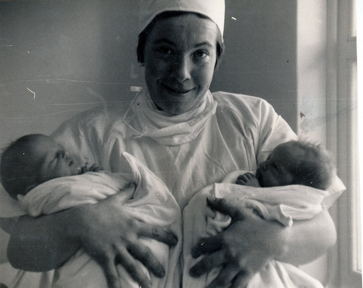 nurse holding 2 babies_who?
