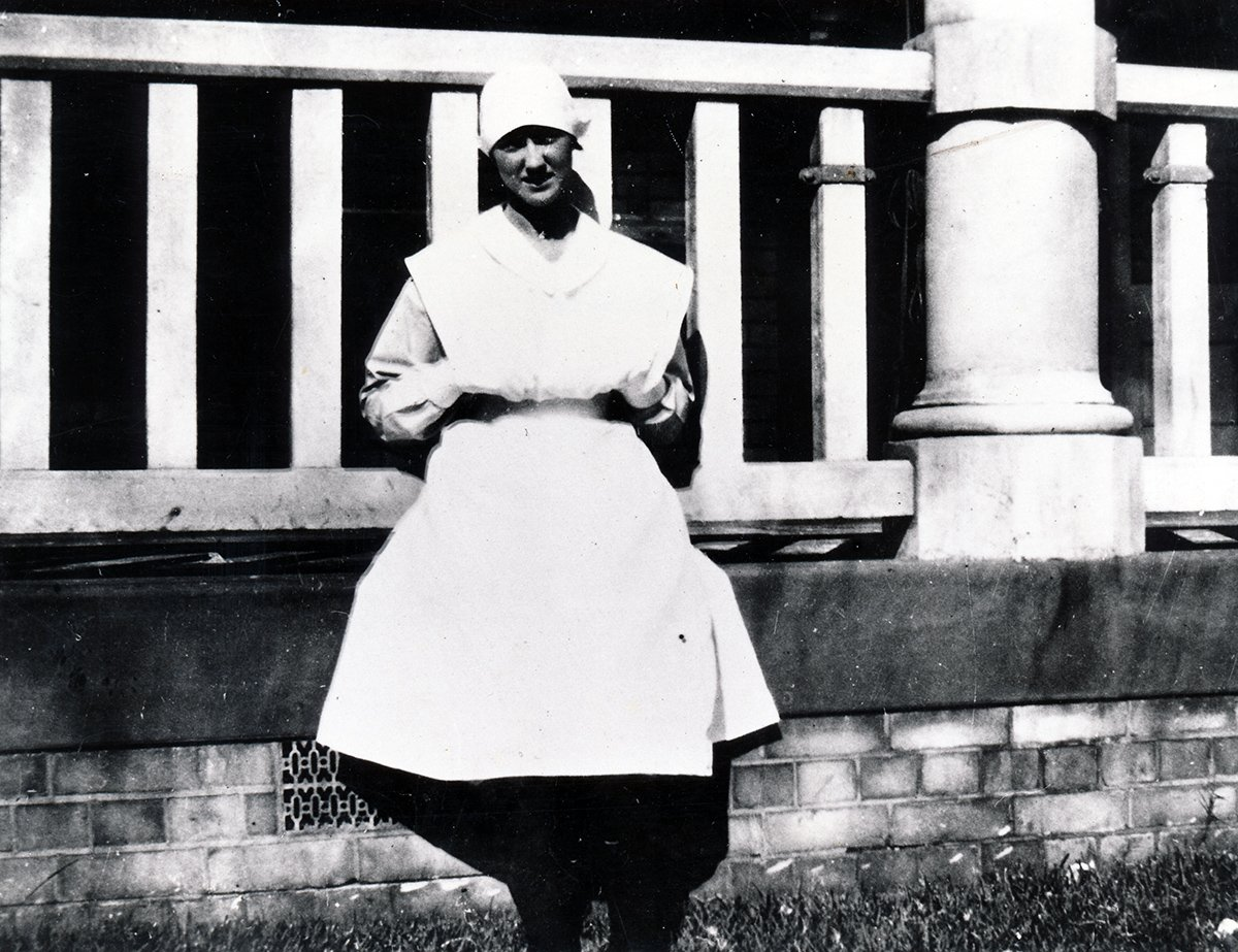 nurse seated outside ward