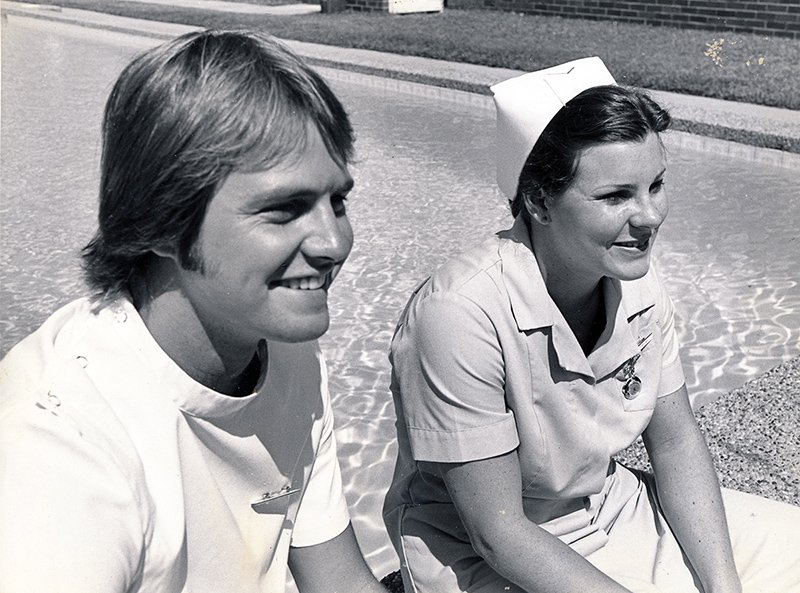 1990s_male & female nurse by the pool
