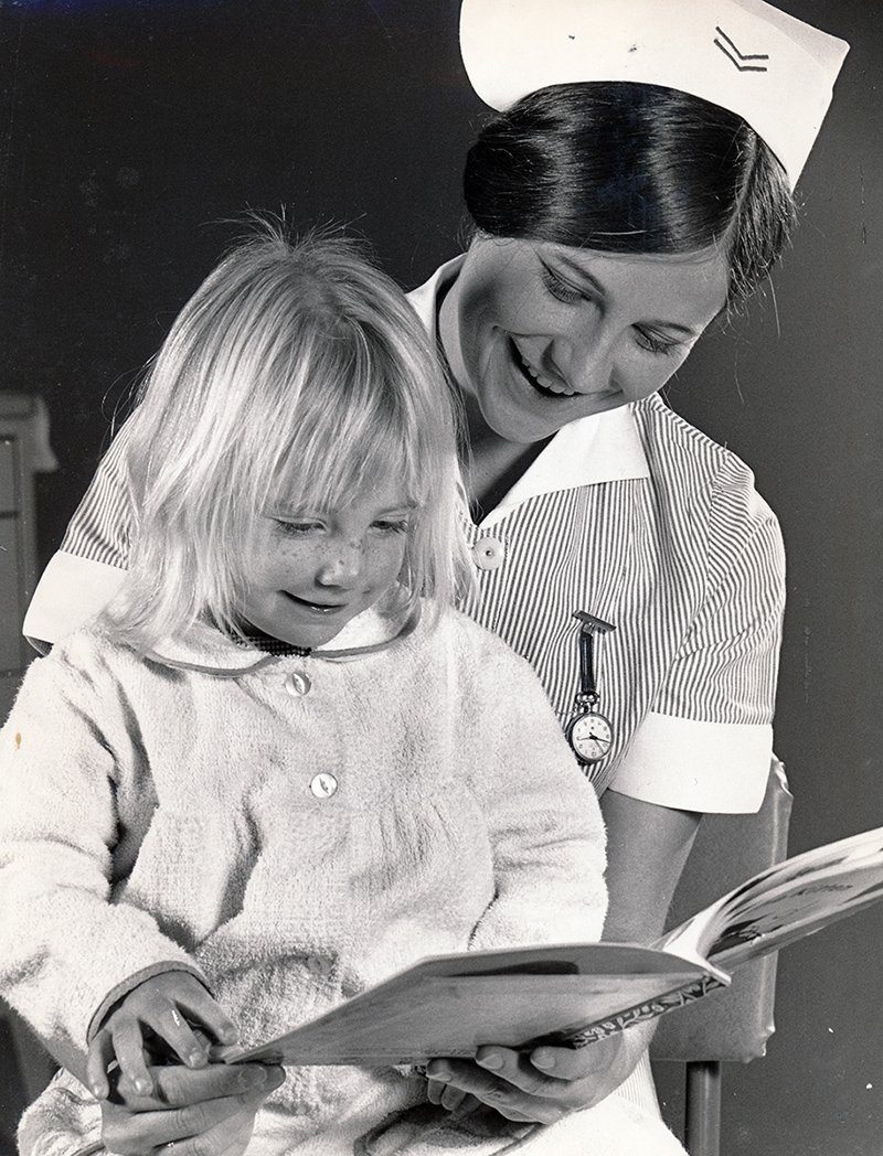1990s_reading to a child