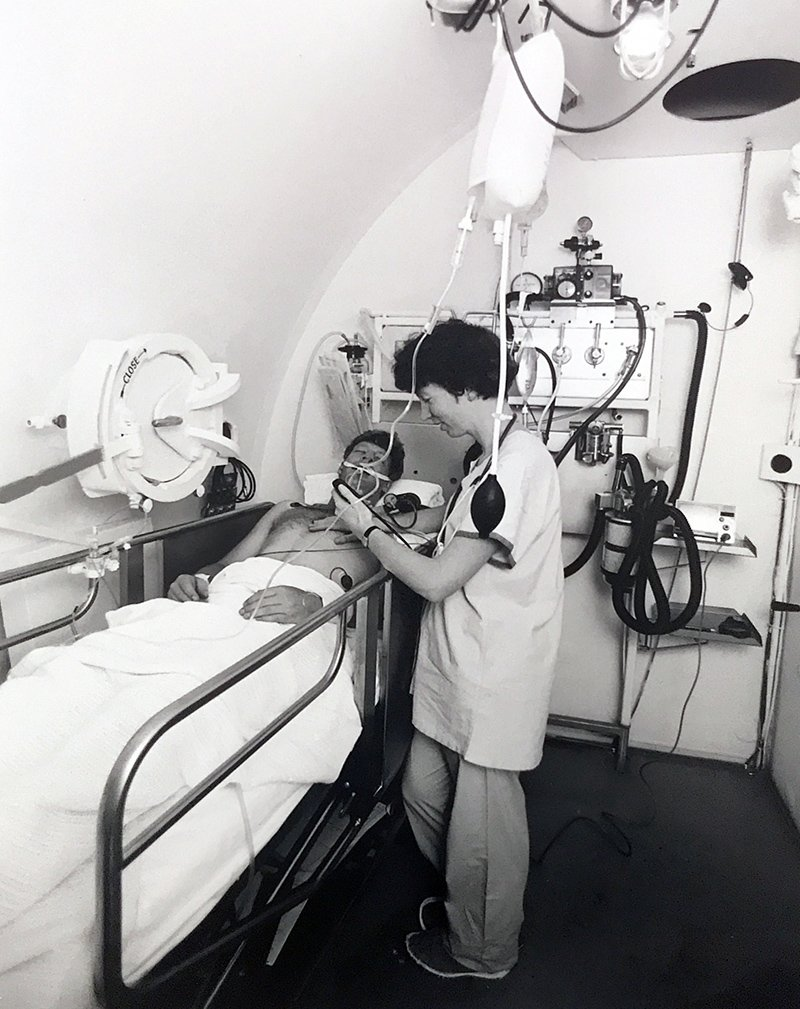 Nurse Niky yee attends to a patient inside the chamber.
