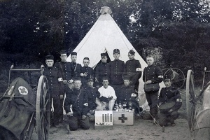 Group portrait of brothers of the Red Cross in front of a tent