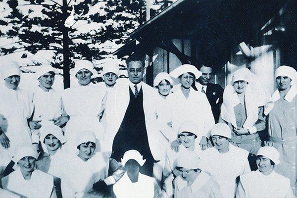 1930s Graduate nurses with doctor
